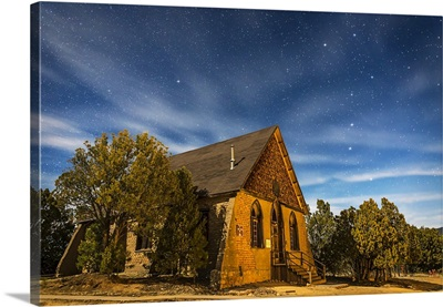 A moonlit nightscape of the historic Hearst Church in Pinos Altos, New Mexico