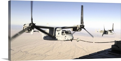 A MV22 Osprey refuels midflight while another waits its turn