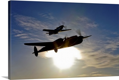 A P 38 Lightning and P 51D Mustang in flight