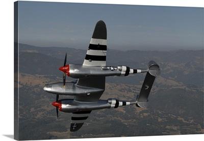 A P-38 Lightning in flight over Santa Rosa, California