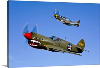 A P 40E Warhawk and a P 51D Mustang Kimberly Kaye in flight