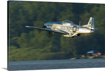 A P-51 Mustang flies along the Mississippi at Dubuque, Iowa