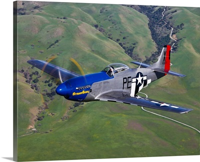 A P-51D Mustang in flight over Hollister, California