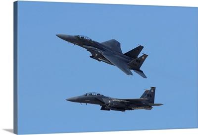 A pair of F-15C Eagle aircraft perform maneuvers at an airshow