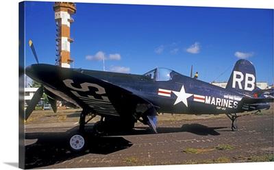A side view of a US Marine Corps F4U Corsair World War II aircraft