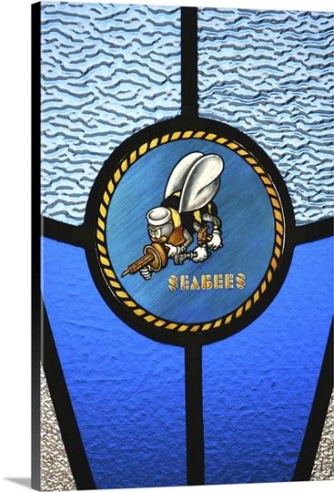 A single Seabee logo built into a stainedglass window