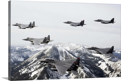 A sixship formation of aircraft fly over the Sawtooth Mountains in Idaho
