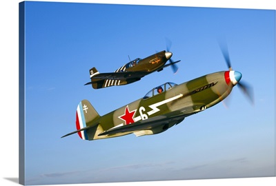 A Soviet Yakovlev Yak 3 and a P 51A Mustang in flight