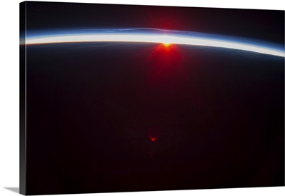 A sunset over the Aleutian Islands, with noctilucent clouds