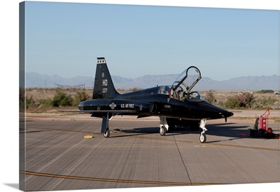 A T-38 pilot prepares to taxi his aircraft for a training mission