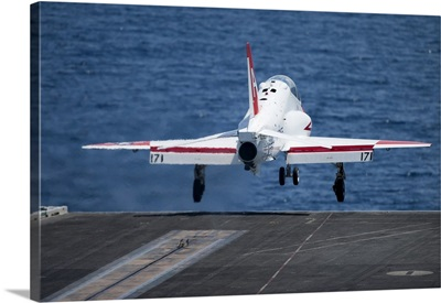 A T-45C Goshawk launches from the flight deck of USS Harry S. Truman