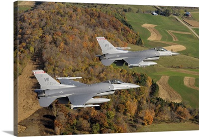 A two-ship formation of F-16 Fighting Falcons on a routine training mission