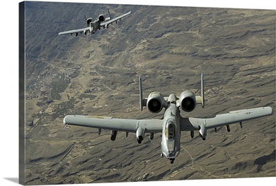 A twoship A10 Thunderbolt II formation flies a combat mission over Afghanistan