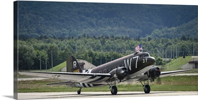 A U.S. Air Force C-47 Skytrain aircraft lands at Ramstein Air Base, Germany