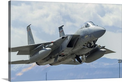 A U.S. Air Force F-15C Eagle taking off from Nellis Air Force Base