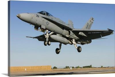 A U.S. Navy F/A-18C Hornet prepares for landing