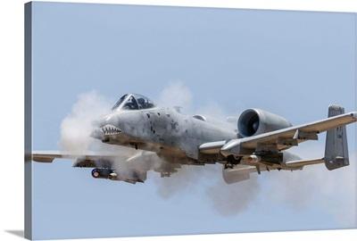 A US Air Force A-10 Thunderbolt II fires its 30mm gun at a strafe target