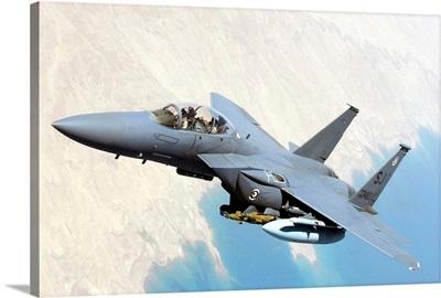 A US Air Force F-15E Strike Eagle aircraft flies over Iraq