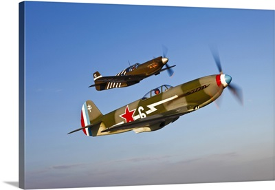 A Yakovlev Yak-9 fighter plane and a P-51A Mustang in flight