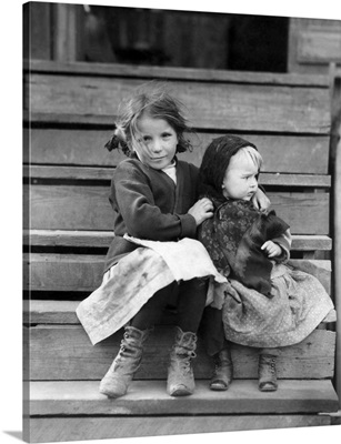 A Young Child Tending To Her Younger Sister In Bayou La Batre, Alabama