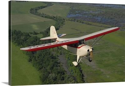 Aeronca Chief flying over Sacramento Valley, California