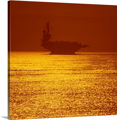 Aircraft carrier at sunset