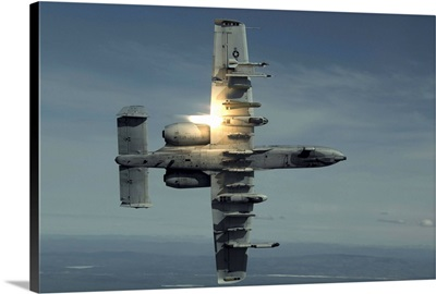 An A-10 Warthog breaks over the Pacific Alaska Range Complex during live fire training
