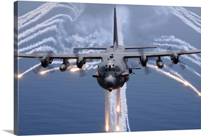 An AC-130H gunship aircraft jettisons flares as an infrared countermeasure