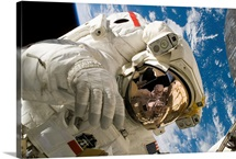 An astronaut mission specialist participates in extravehicular activity