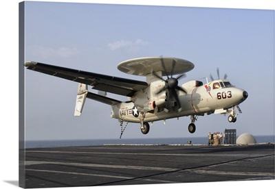 An E-2C Hawkeye landing on the flight deck of USS George H.W. Bush