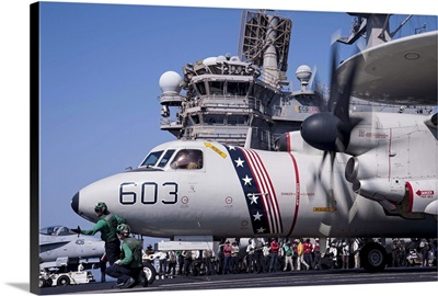 An E-2C Hawkeye prepares to launch from the flight deck of USS George H.W. Bush