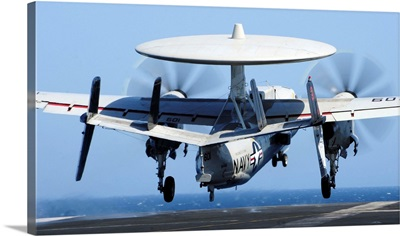 An E-2C Hawkeye takes off from the flight deck of USS George Washington