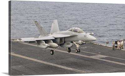 An EA-18G Growler landing on the flight deck of USS George H.W. Bush