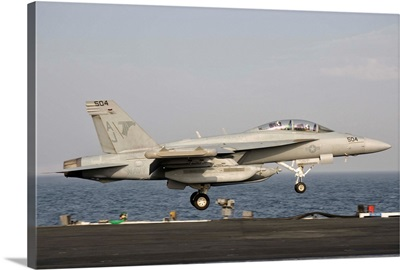 An EA-18G taking off from the flight deck of USS George H.W. Bush