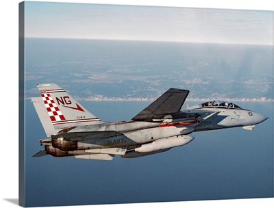 An F-14A Tomcat cruises near Virginia Beach during a morning training mission