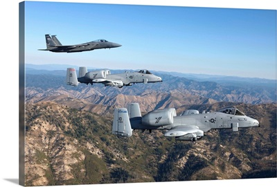 An F-15 Eagle and two A-10 Thunderbolts in flight over Central Idaho