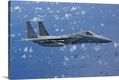 An F-15 Eagle flies over the Pacific Ocean during a training mission