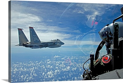 An F-15 Eagle pilot flies in formation with his wingman