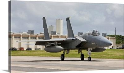 An F-15 Eagle taxies to the end of runway at Kadena Air Base, Japan