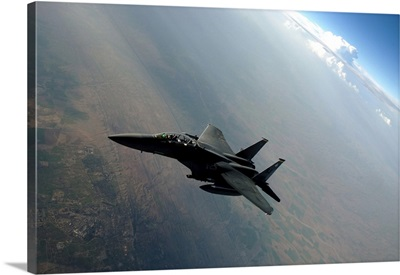 An F-15E Strike Eagle breaks away from a KC-135 Stratotanker after refueling