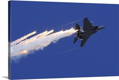 An F-15E Strike Eagle releases flares