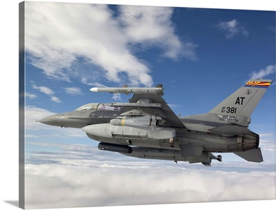 An F-16 Fighting Falcon flies with an AGM-65 Maverick missile