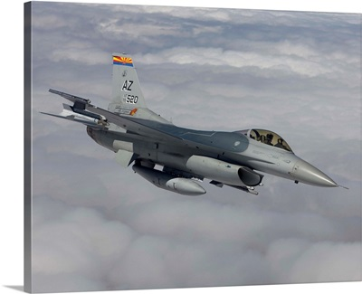An F-16 Fighting Falcon maneuvers during a training mission