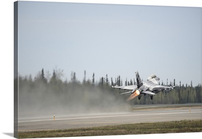 An F-16 Fighting Falcon takes off Eielson Air Force Base