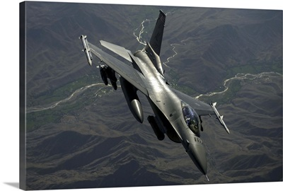 An F-16C Fighting Falcon flies over Afghanistan