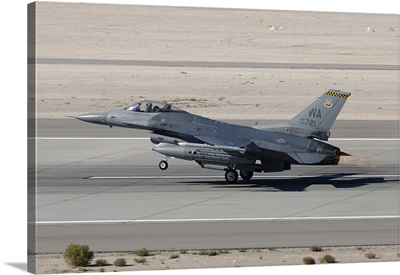 An F-16C Fighting Falcon taking off from Nellis Air Force Base