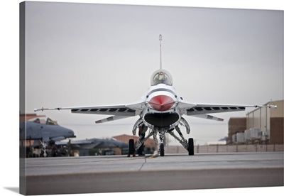 An F-16C Thunderbird sits on the ramp at Nellis Air Force Base, Nevada