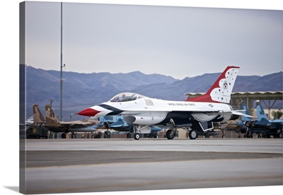 An F-16C Thunderbird taxis to the runway at Nellis Air Force Base, Nevada