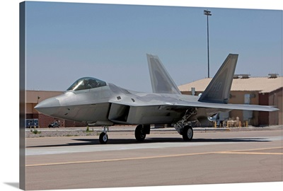 An F-22 Raptor taxies to the runway for a training mission