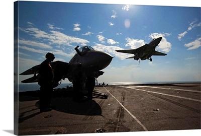 An F14D Tomcat prepares to make an arrested landing aboard USS Theodore Roosevelt